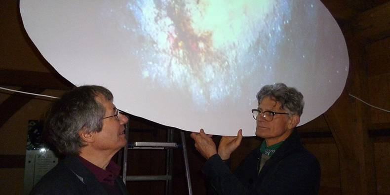 Tim Cook's (left) 17-minute composition played on a loop to accompany video images from the Hubble Telescope